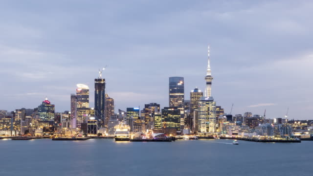 dusk to night timelapse of auckland harbour / auckland, new zealand - new zealand stock videos & royalty-free footage