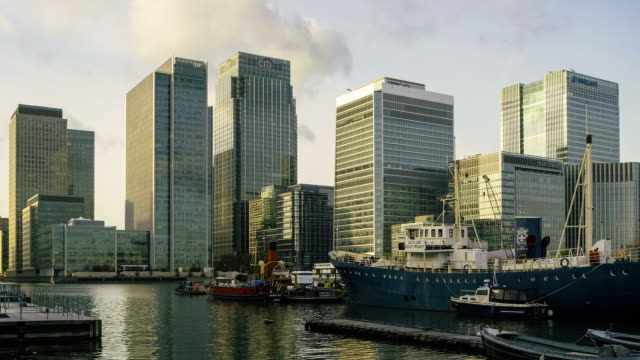 dusk to night time-lapse of the canary wharf, london docklands, uk - dusk to night stock videos and b-roll footage
