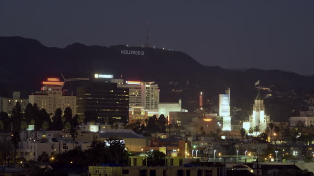 t/l ha ws dusk to night view of cityscape near hollywood sign on hill / hollywood, california, usa - hollywood sign stock videos & royalty-free footage