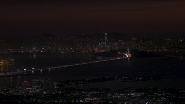 dusk view of san francisco and san franciscooakland bay bridge during pge power outage emeryville in foreground - twilight stock videos & royalty-free footage