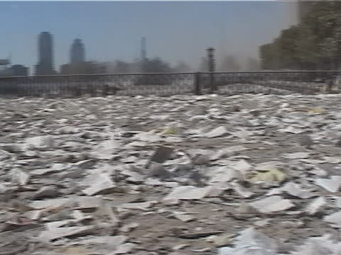 stockvideo's en b-roll-footage met dust and paper cover the boat basin behind the world financial center during the late afternoon on september 11, 2001 in new york city, usa. the... - september 11 2001 attacks