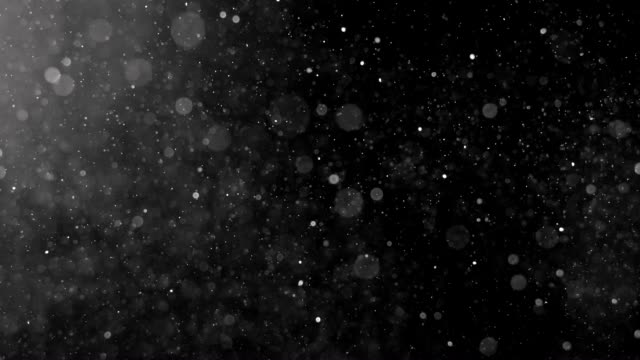dust particles shot on black. - particle stock videos and b-roll footage