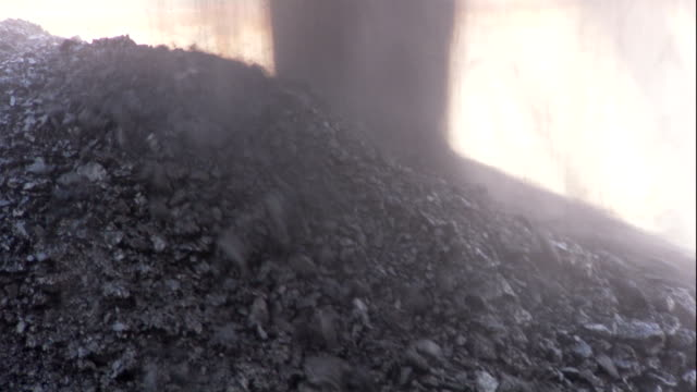 dust rises as coal pours into a pile. - coal stock videos & royalty-free footage