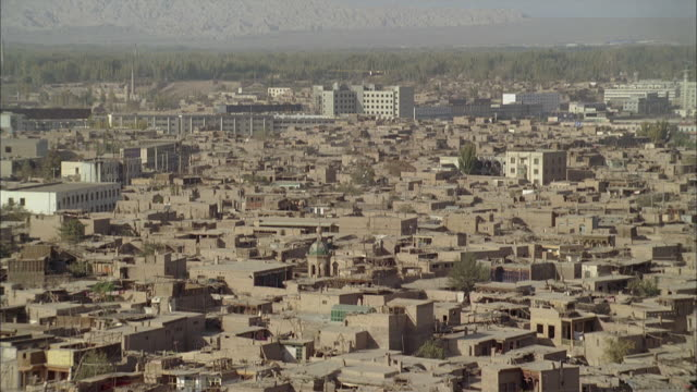 dusty houses crowd a sprawling neighborhood in afghanistan. - afghanistan stock videos & royalty-free footage