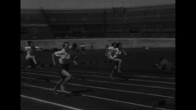 Dutch athlete Fanny BlankersKoen longjumping / 110meter high hurdles BlankersKoen running in lead /official fires starting gun / runners start...