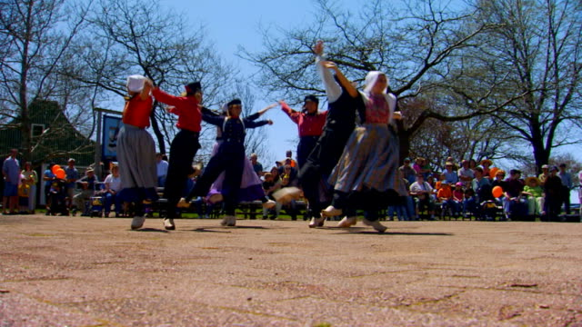 dutch dance routine low angle handheld shot  - traditional clothing stock videos & royalty-free footage