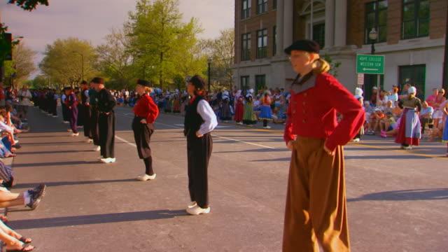 vidéos et rushes de dutch dancers dancing in the streets - sabot
