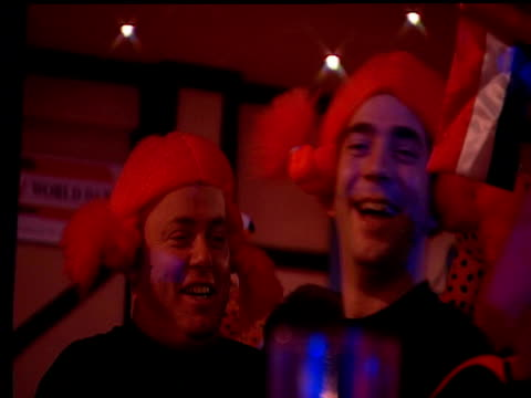 dutch fans wearing orange wigs and drinking lager 2003 embassy world darts championships lakeside frimley green - lager stock videos & royalty-free footage