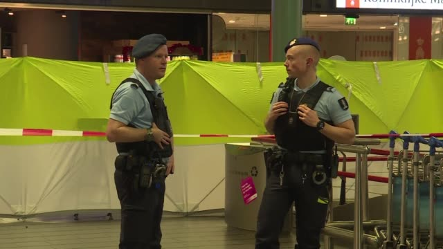 Dutch military police shot and wounded a man armed with a knife who burst into their office at Schiphol airport in an incident which triggered panic...