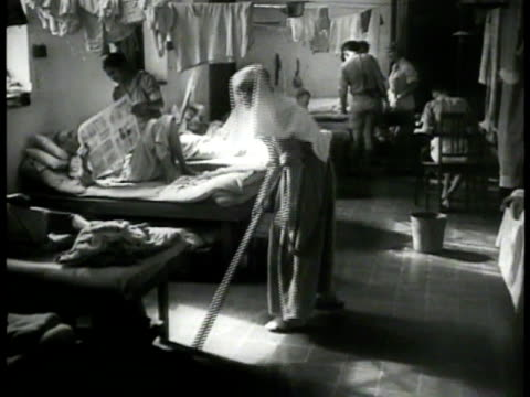 dutch nurses woman cleaning floor sick injured ms skinny malnutrition starving man laying in bed indonesia wwii - prison camp stock videos & royalty-free footage