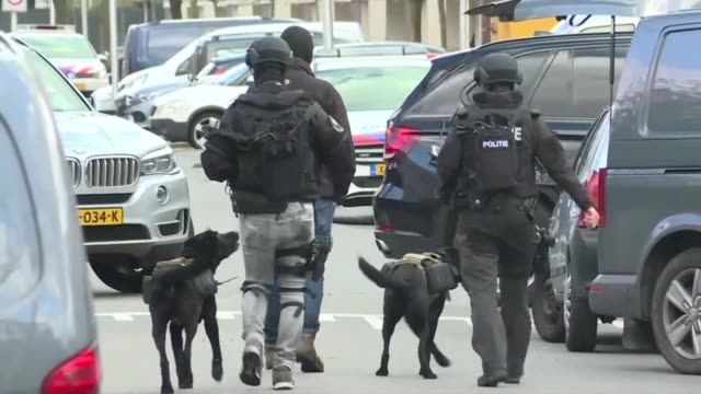 dutch police conduct a huge manhunt for a gunman who killed three people and wounded nine others in a suspected terror attack inside a tram in the... - utrecht stock videos & royalty-free footage