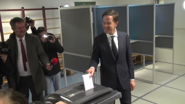 dutch prime minister and leader of the vvd liberal party mark rutte casts his ballot for the parliamentary election at a polling station in the hague... - オランダ点の映像素材/bロール