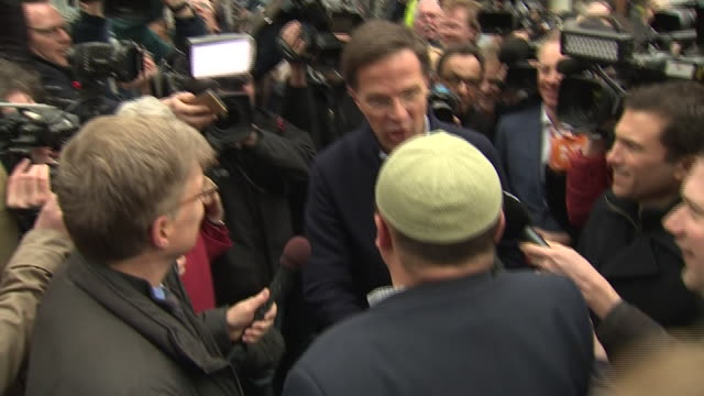 dutch prime minister mark rutte greeting reporters and supporters on the campaign trail in the hague - the hague stock videos and b-roll footage