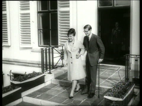b/w dutch princess and fiance come out to meet the press / 1960's / sound - paar mittleren alters stock-videos und b-roll-filmmaterial