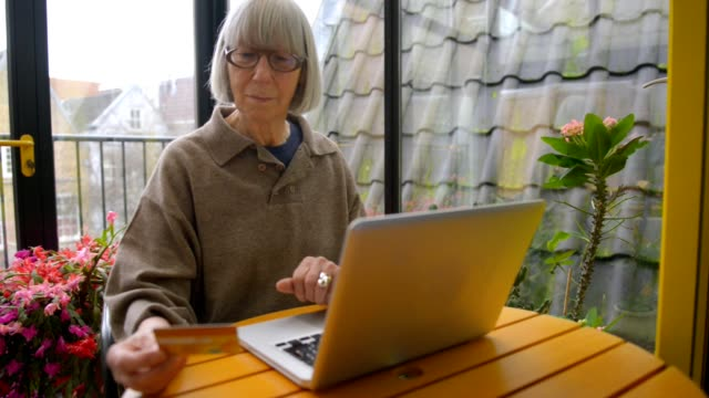 Dutch senior woman using technology