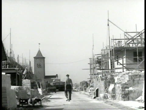 Dutch worker walking houses under construction MS Topless men laying brick MS Workers laying brick Rotterdam Post World War II