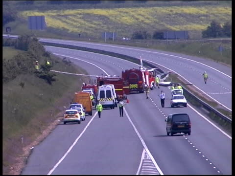 crash; lib m11 motorway: ext emergency services at scene of light plane crash on m11 - airshow stock videos & royalty-free footage