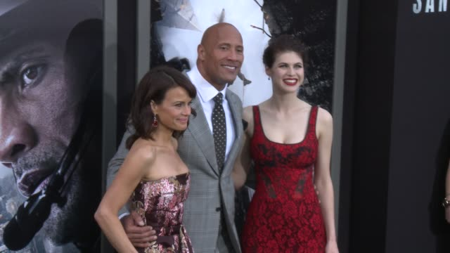 Dwayne Johnson Carla Gugino and Alexandra Daddario at the 'San Andreas' Los Angeles World Premiere at TCL Chinese Theatre on May 26 2015 in Hollywood...