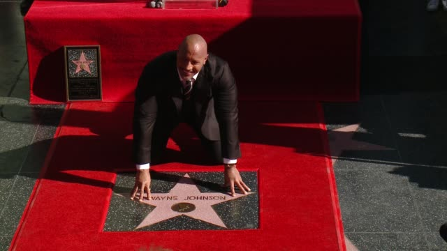 stockvideo's en b-roll-footage met clean dwayne johnson honored with a star on the hollywood walk of fame on december 13 2017 in hollywood california - hollywood walk of fame