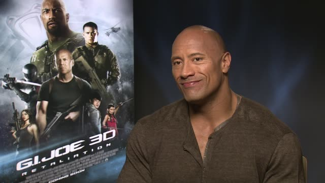 vídeos de stock, filmes e b-roll de dwayne johnson on the least macho thing he's had to do as a father at 'gi joe: retaliation' junket interviews at corinthia hotel london on march 18,... - masculinidade