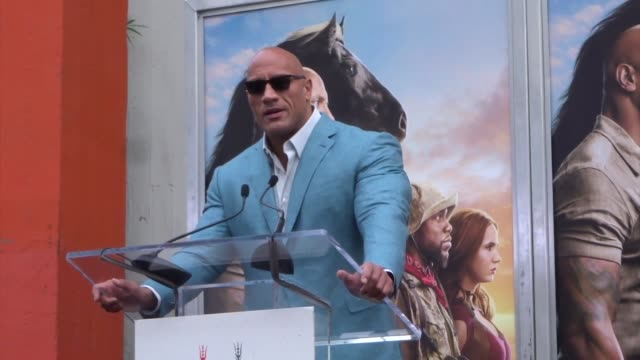 dwayne johnson speaks at kevin hart's hand and footprint ceremony at tcl chinese theatre in hollywood in celebrity sightings in los angeles, - celebrity sightings stock videos & royalty-free footage