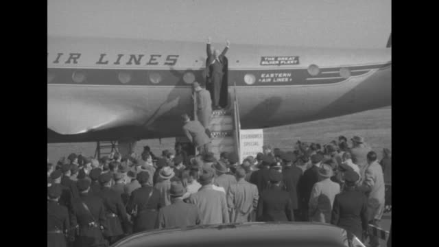 vs dwight d eisenhower boarding eastern air lines airplane crowd of reporters on tarmac sign next to plane says eisenhower special eisenhower turns... - 1952 stock videos and b-roll footage