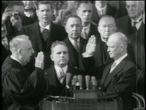 vidéos et rushes de dwight d eisenhower takes oath of office / shakes hands with truman nixon kisses mamie - 1953