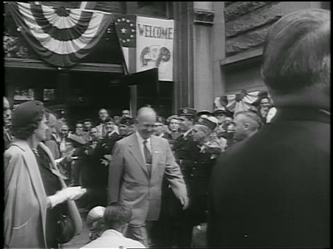 dwight d eisenhower walks thru clapping crowd during whistlestop campaign / newsreel - anno 1952 video stock e b–roll