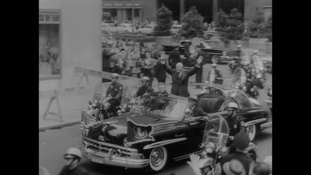 dwight eisenhower applauded in open motorcade - anno 1960 video stock e b–roll
