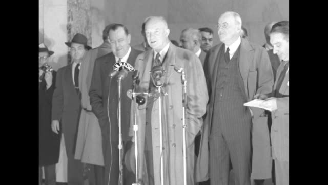 SOT Dwight Eisenhower at microphones references President of the General Assembly Lester B Pearson / Secretary of State nominee John Foster Dulles at...
