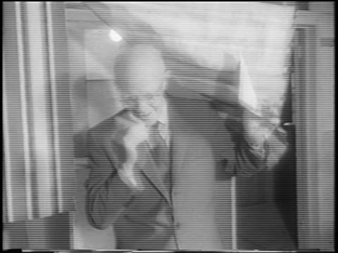 dwight eisenhower exiting voting booth during presidential election / newsreel - anno 1960 video stock e b–roll