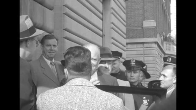 Dwight Eisenhower Republican candidate for the US presidency leaves polling place gives V for victory signs to crowd and says I'm going for a rest to...