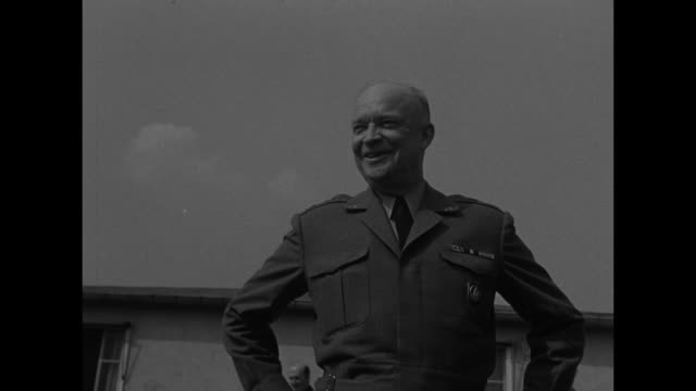 vídeos de stock, filmes e b-roll de dwight eisenhower supreme allied commander europe and britain's lord ismay walk together towards camera buildings of rocquencourt headquarters behind... - dwight eisenhower