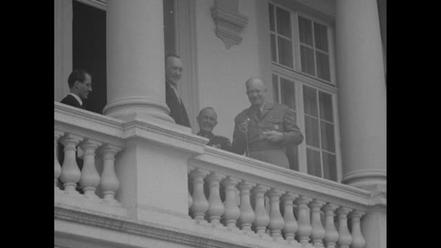 vs dwight eisenhower supreme commander of nato standing on balcony of palais schaumburg with west german chancellor konrad adenauer and other... - palast stock-videos und b-roll-filmmaterial