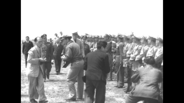 dwight eisenhower us army chief of staff climbs down ladder from us army air forces plane on airfield and is greeted by officials / us and chinese... - chiang kai shek stock videos and b-roll footage