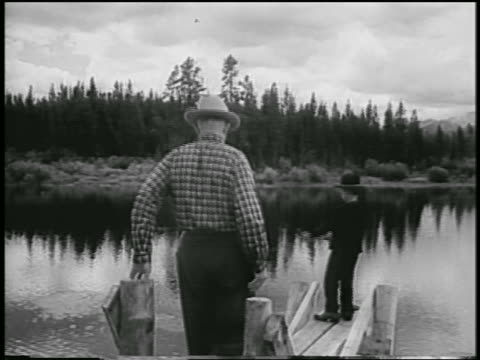 dwight eisenhower walking toward grandson david fishing on dock - 1954 stock videos & royalty-free footage