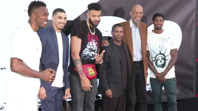Dwight Howard Kareem AbdulJabbar and Denzel Washington at the 'The Equalizer 2' Premiere at TCL Chinese Theatre on July 17 2018 in Hollywood...