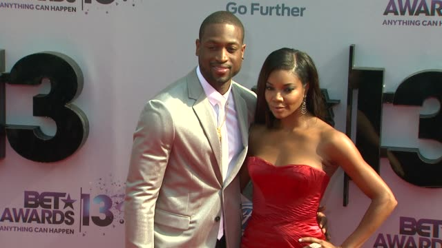 dwyane wade gabrielle union at bet 2013 awards arrivals on 6/30/13 in los angeles ca - bet awards stock-videos und b-roll-filmmaterial