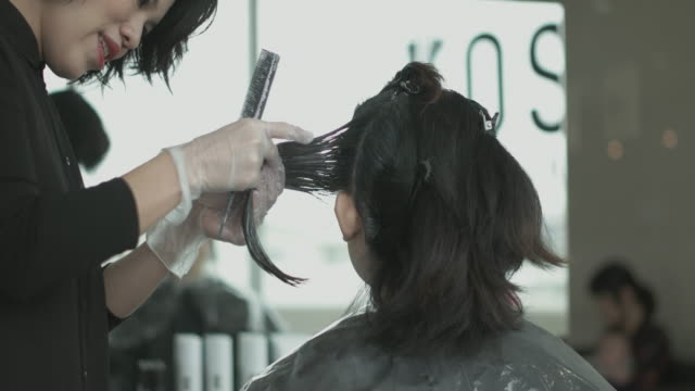 dyed hair at beauty salon. japan - pampering self stock videos and b-roll footage