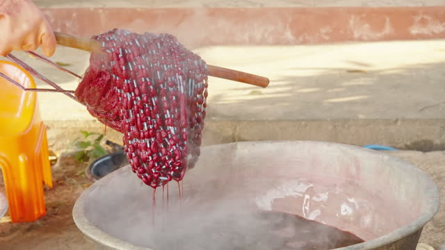 dyeing local style mudmee cloth handmade work, silk weaving, weaving products in rural communities in thailand. - silk stock videos & royalty-free footage