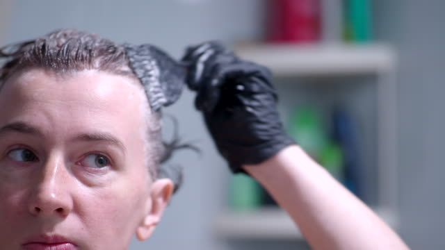 dying hair - colouring stock videos & royalty-free footage