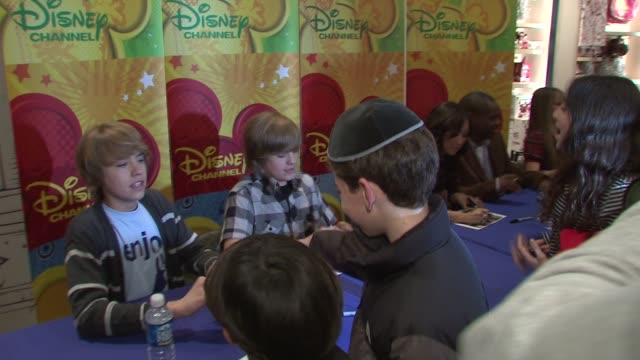 dylan sprouse cole sprouse brenda song and debby ryan at the cast of the suite life on deck at world of disney in new york at new york ny - brenda song stock videos & royalty-free footage