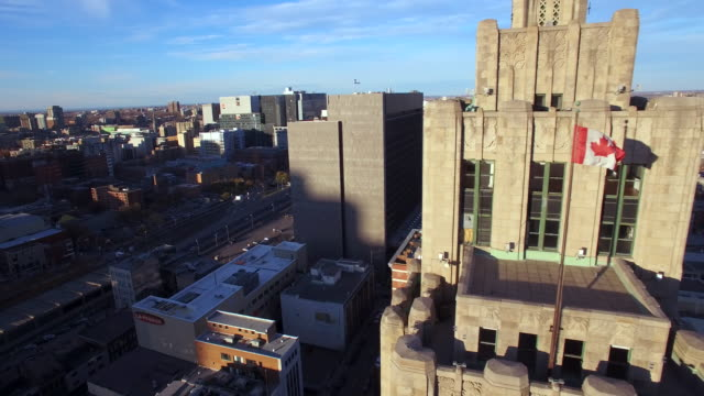 Dynamic aerial view of building in downtown Montreal to reveal city scape