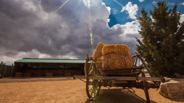 dynamic clouds over a hay cart - horse cart stock videos and b-roll footage