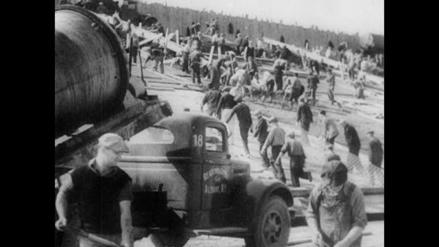 stockvideo's en b-roll-footage met dynamite explodes in quarry / construction vehicles lay roads that are paved and graded / men working in the state park / a concrete bed is laid for... - 1936