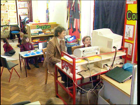 faulty gene identified lib primary school children in classroom pan boy working at computer boy working at computer - learning disability stock videos & royalty-free footage