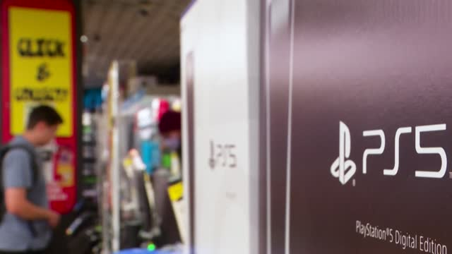 eager gamers pick-up their playstation 5 orders from stores in sydney but due to covid-19 all consoles were sold through pre-orders and most... - sony stock videos & royalty-free footage