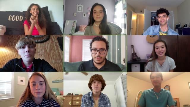 eager students attempt to answer questions during online homeschooling lesson (audio) - webbkamera bildbanksvideor och videomaterial från bakom kulisserna