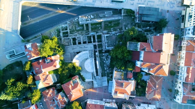 eagle eye view descending drone shot over ancient roman remains in the city of plovdiv - moving down video stock e b–roll