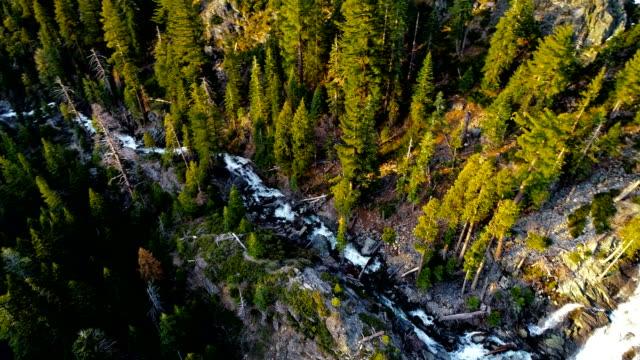 stockvideo's en b-roll-footage met eagle falls, waterval drone weergave draaien na stream neer in lake tahoe en eindigend met de fantastische zonsopgang - californian sierra nevada